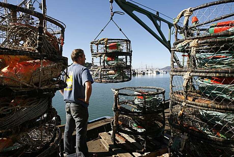 Don Barker loads crab pots onto a fishing boat as commercial fishermen prepare for the opening of crab season on Pier 45 in San Francisco, Calif., on Friday, Nov. 12, 2010. Photo: Paul Chinn, The Chronicle