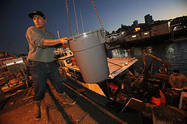 "Captain John Atkinson unloads the first 9,000 pounds of crab to Albers Seafood at pier 45 aboard his sports fishing boat ""New Rayann"" for the opening of the Dungeness crab season in San Francisco, Calif.., on Tuesday, November 16, 2010.   Kat Wade / Special to the Chronicle Photo: Kat Wade, Special To The Chronicle"