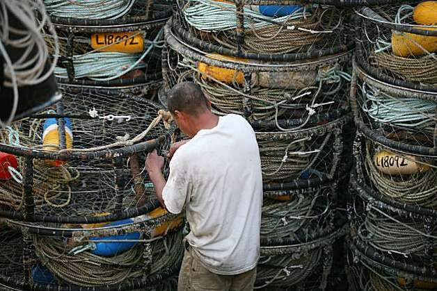 "3rd mate Daniel Kelly tie down 500 crab pots on the crab boat ""Madeline"" owned by captain Bob Burchell as they prepare to ship out for the opening of the Dungeness crab season in San Francisco, Calif, on Tuesday, November 16, 2010.   Kat Wade / Special to the Chronicle Photo: Kat Wade, Special To The Chronicle"