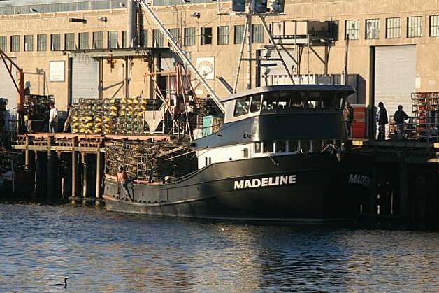 Crew load crab pots aboard the Madeline owned by Captain Bob Burchell at pier 45 for the opening of the Dungeness crab season in San Francisco, Calif.., on Friday, December 17, 2010.   Kat Wade / Special to the Chronicle Photo: Kat Wade, Special To The Chronicle