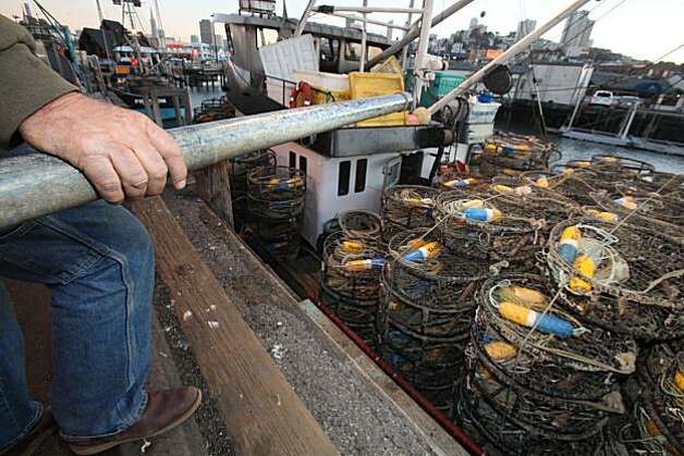 "Captain Bob Burchell loads 500 crab pots on his boat ""Madeline"" as he prepares to ship out for the opening of the Dungeness crab season in San Francisco, Calif, on Tuesday, November 16, 2010.   Kat Wade / Special to the Chronicle Photo: Kat Wade, Special To The Chronicle"