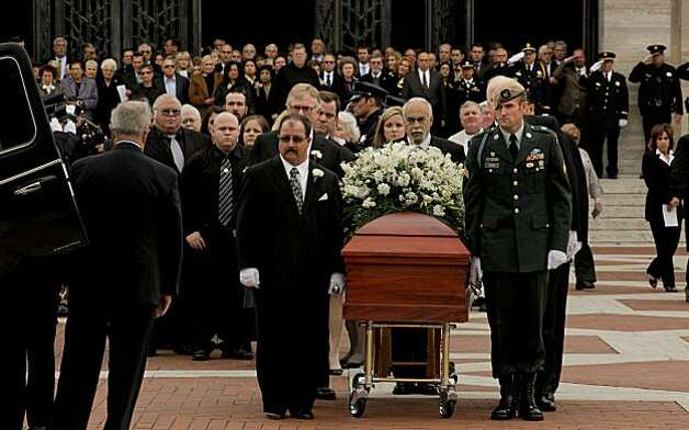 The casket of former San Francisco Police Chief Alex Fagan is wheeled out of the memorial service, at St. Mary's Cathedral in San Francisco, Calif., on Friday Nov. 19, 2010. Photo: Michael Macor, The Chronicle
