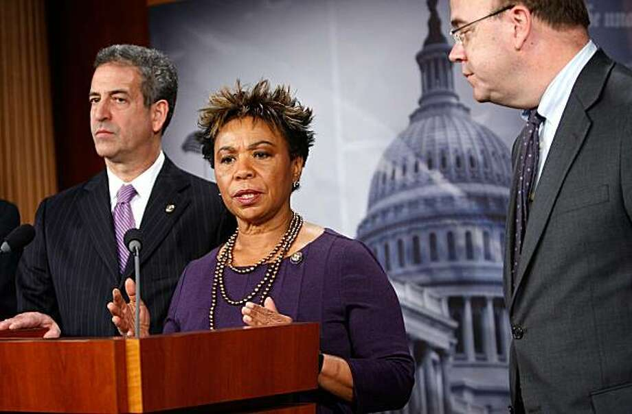 WASHINGTON - DECEMBER 01:  U.S. Rep. Barbara Lee (D-CA) (2nd L) speaks as Sen. Russell Feingold (D-WI) (L), and Rep. James McGovern (D-MA) (R) listen during a news conference on Capitol Hill December 1, 2009 in Washington, DC.  The legislators held a news conference to voice their oppositions on the Obama administration's decision to send 30,000 more troops to war in Afghanistan.  (Photo by Alex Wong/Getty Images) Photo: Alex Wong, Getty Images