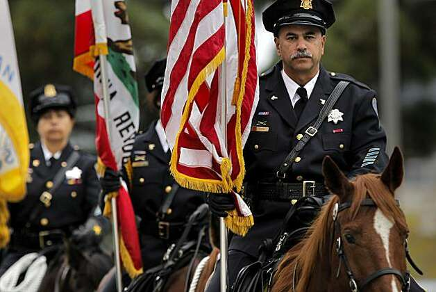 San Francisco plice officer, Jeff Roth leads the mounted patrol color guard, as family, friends and officers pay their respects to former San Francisco Police Chief Alex Fagan at a memorial service, at St. Mary's Cathedral in San Francisco, Calif., on Friday Nov. 19, 2010. Photo: Michael Macor, The Chronicle