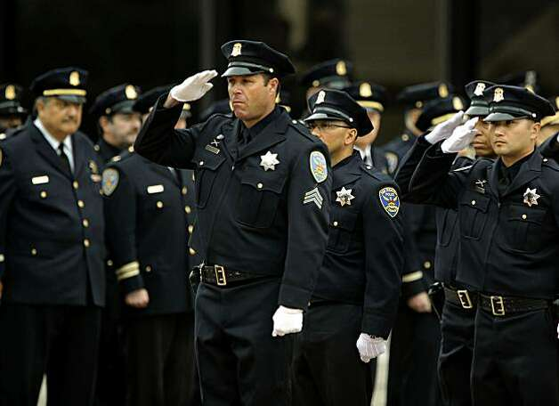 San Francisco police officers salute as the casket of former San Francisco Police Chief Alex Fagan is carried into the memorial service, at St. Mary's Cathedral in San Francisco, Calif., on Friday Nov. 19, 2010. Photo: Michael Macor, The Chronicle