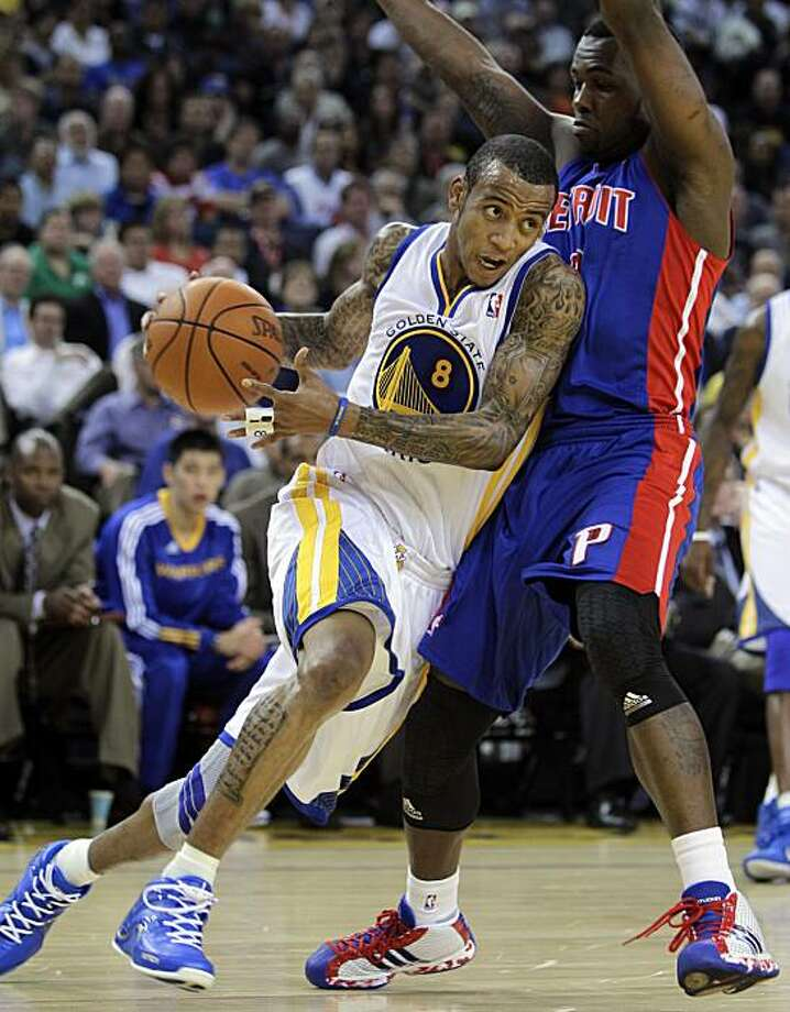 Golden State Warriors' Monta Ellis (8) drives past Detroit Pistons' Rodney Stuckey during the first half of an NBA basketball game Monday, Nov. 15, 2010, in Oakland, Calif. Photo: Ben Margot, AP