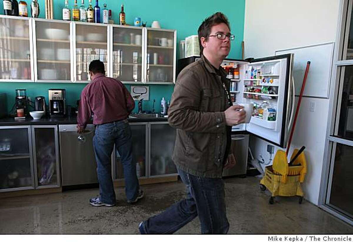After freshening his coffee cup, Biz Stone, co-founder of Twitter.com heads out of the office kitchen ready for the next task on Thursday March 20, 2009 in San Francisco, Calif.