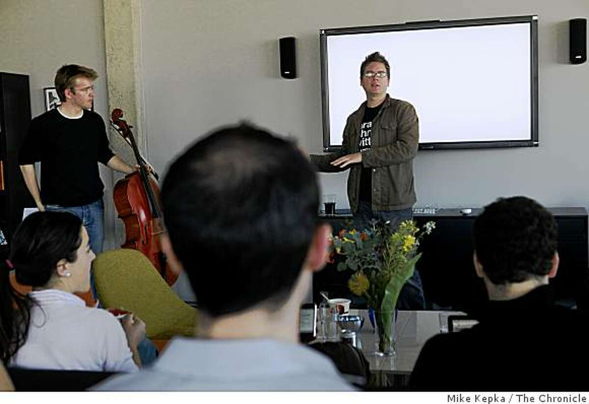 Biz Stone, co-founder of Twitter.com introduces a guest speaker, a Twittering Scottish cellist, during lunch on Thursday March 20, 2009 in San Francisco, Calif.