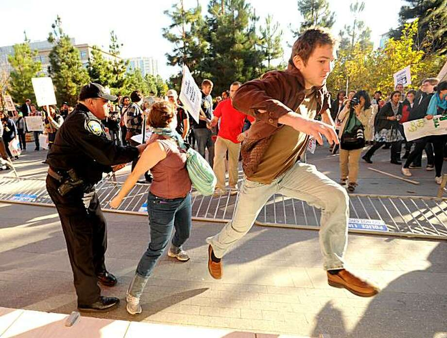 A protester attempts to enter a UC Regents meeting after fellow demonstrators knocked over police barricades on Wednesday, Nov. 11, 2010, in San Francisco. Photo: Noah Berger, Special To The Chronicle