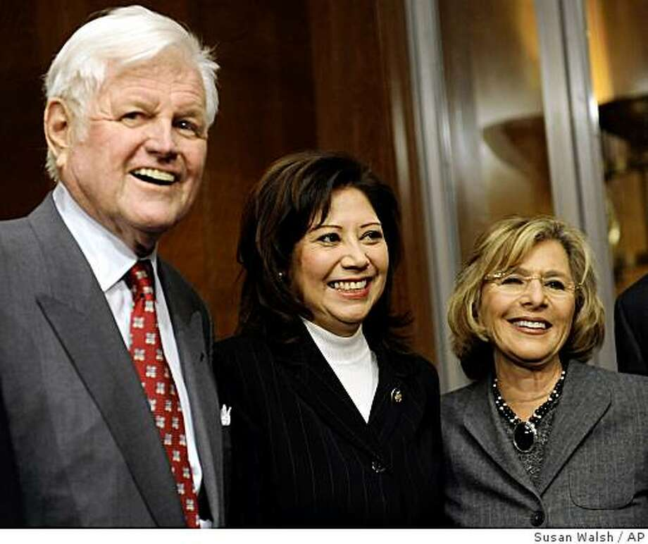 Senate Health, Education, Labor and Pension Committee Chairman Sen. Edward Kennedy, D-Mass., left, stands with Labor Secretary-designate Rep. Hilda Solis, D-Calif., center, and Sen. Barbara Boxer, D-Calif., on Capitol Hill in Washington, Friday, Jan. 9, 2009, before the start of a hearing on Solis' nomination. (AP Photo/Susan Walsh) Photo: Susan Walsh, Associated Press