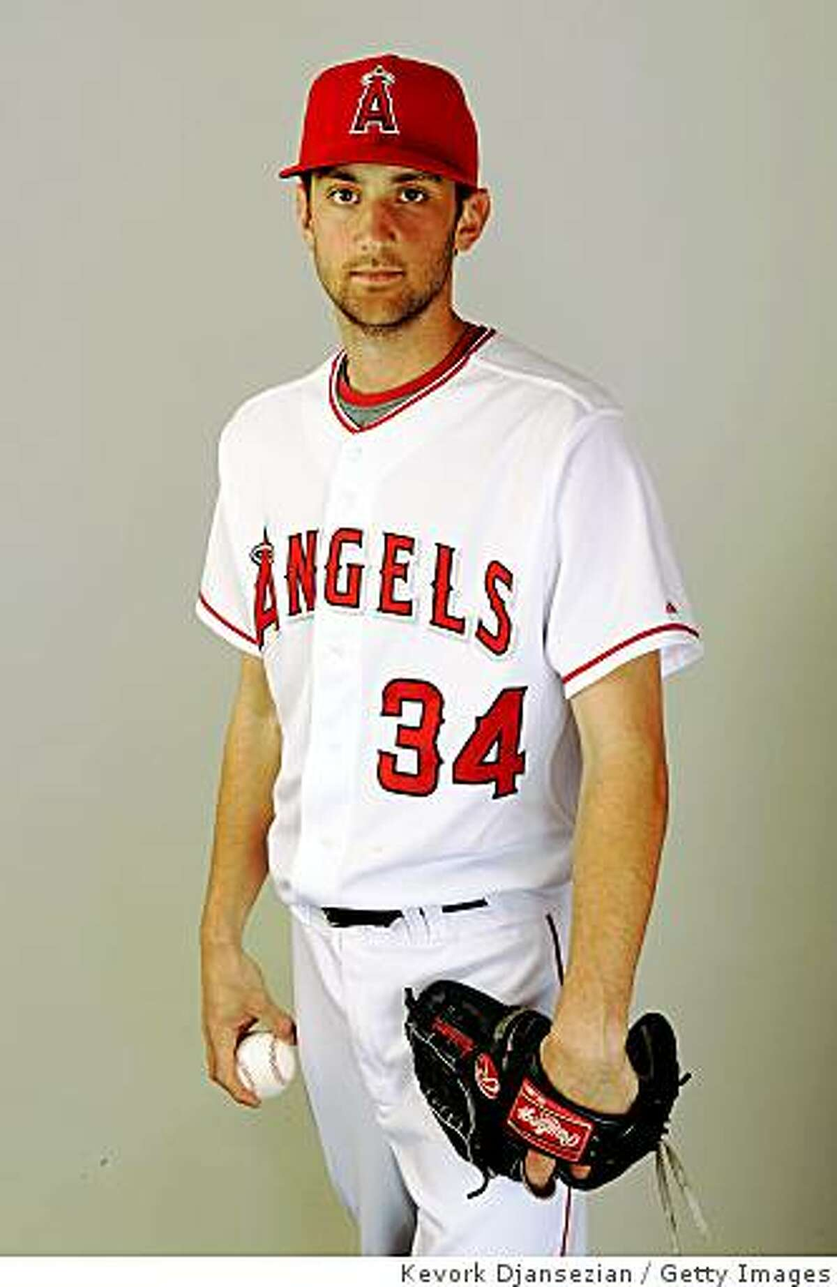 TEMPE, AZ - FEBRUARY 25: (FILE PHOTO) Pitcher Nick Adenhart #34 of the Los Angeles Angels of Anaheim poses for a photo on picture day February 25, 2009 in Tempe, Arizona. Adenhart, a league rookie, was killed in an auto accident early Thursday morning after pitching in a game on April 8. (Photo by Kevork Djansezian/Getty Images)