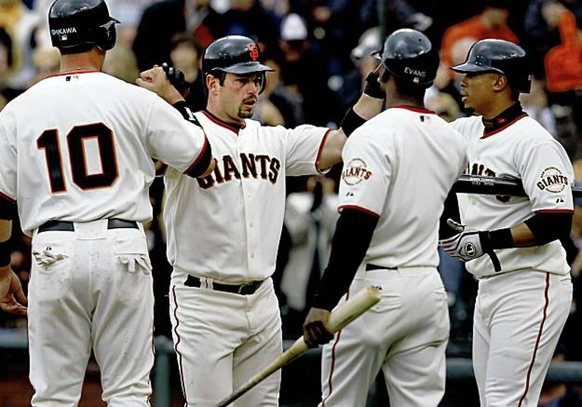 Aaron Rowand is congratulated by teammates after his 4th inning two run home run gave the Giants the lead again. San Francisco Giants vs. Milwaukee baseball opener at AT&T park weather permitting Tuesday April 7, 2009.