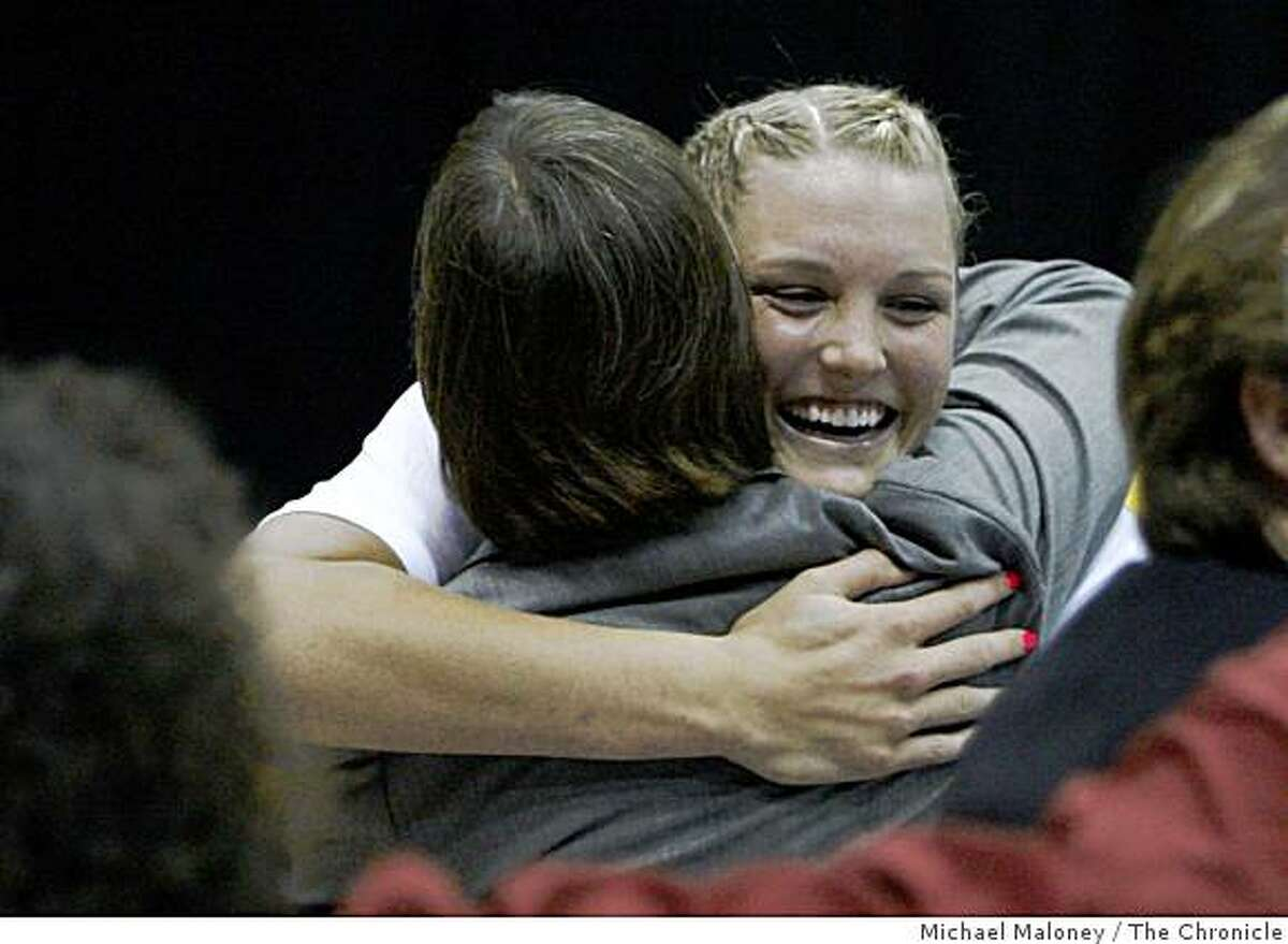 Stanford's Jayne Appel (2) is congratulated by coach Tara VanDerveer after Stanford won the Berkeley Regional Final between Stanford and Iowa State at Haas Pavilion in Berkeley, Calif., on March 30, 2009.