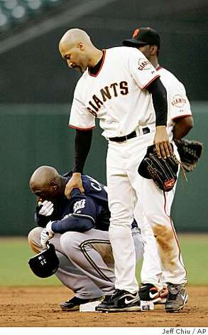 San Francisco Giants' Randy Winn, right, consoles Milwaukee Brewers' Mike Cameron after Cameron's double hit Giants pitcher Joe Martinez in the head during the ninth inning in San Francisco on Thursday. The Giants won 7-1. Martinez left the game. Photo: Jeff Chiu, AP
