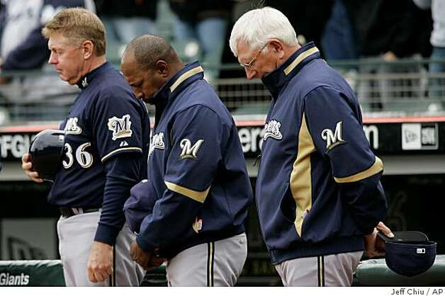 Milwaukee Brewers coaches Brad Fisher, left, Willie Randolph, center, and manager Ken Macha observe a moment of silence for Los Angeles Angels pitcher Nick Adenhart before a game against the San Francisco Giants in San Francisco, Thursday, April 9, 2009. Photo: Jeff Chiu, AP