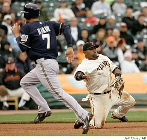 San Francisco Giants' Pablo Sandoval, right, throws to second base to force out Milwaukee Brewers' Mike Cameron on Corey Hart's fielder's choice in the seventh inning of a game in San Francisco, Thursday, April 9, 2009. The Giants won 7-1. At left is J.J. Hardy. Photo: Jeff Chiu, AP
