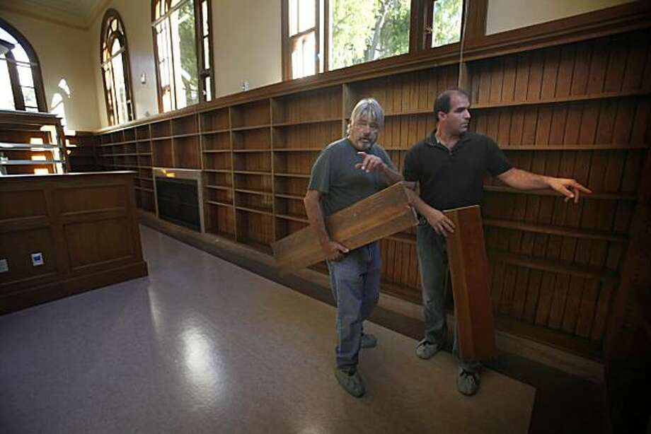 Bill Flagg, left, superintendent of Roebuck Construction, and Chris Bussani, project manager at Roebuck Construction, work in the reading room at the Presidio Branch Library on Tuesday, November 16, 2010, in San Francisco. Photo: Lea Suzuki, The Chronicle