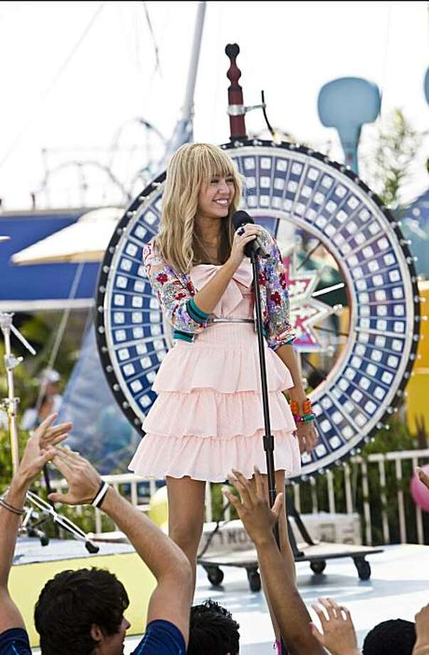 "In this image released by Disney Enterprises, Miley Cyrus is shown in a scene from ""Hannah Montana: The Movie."" Photo: Sam Emerson, AP"