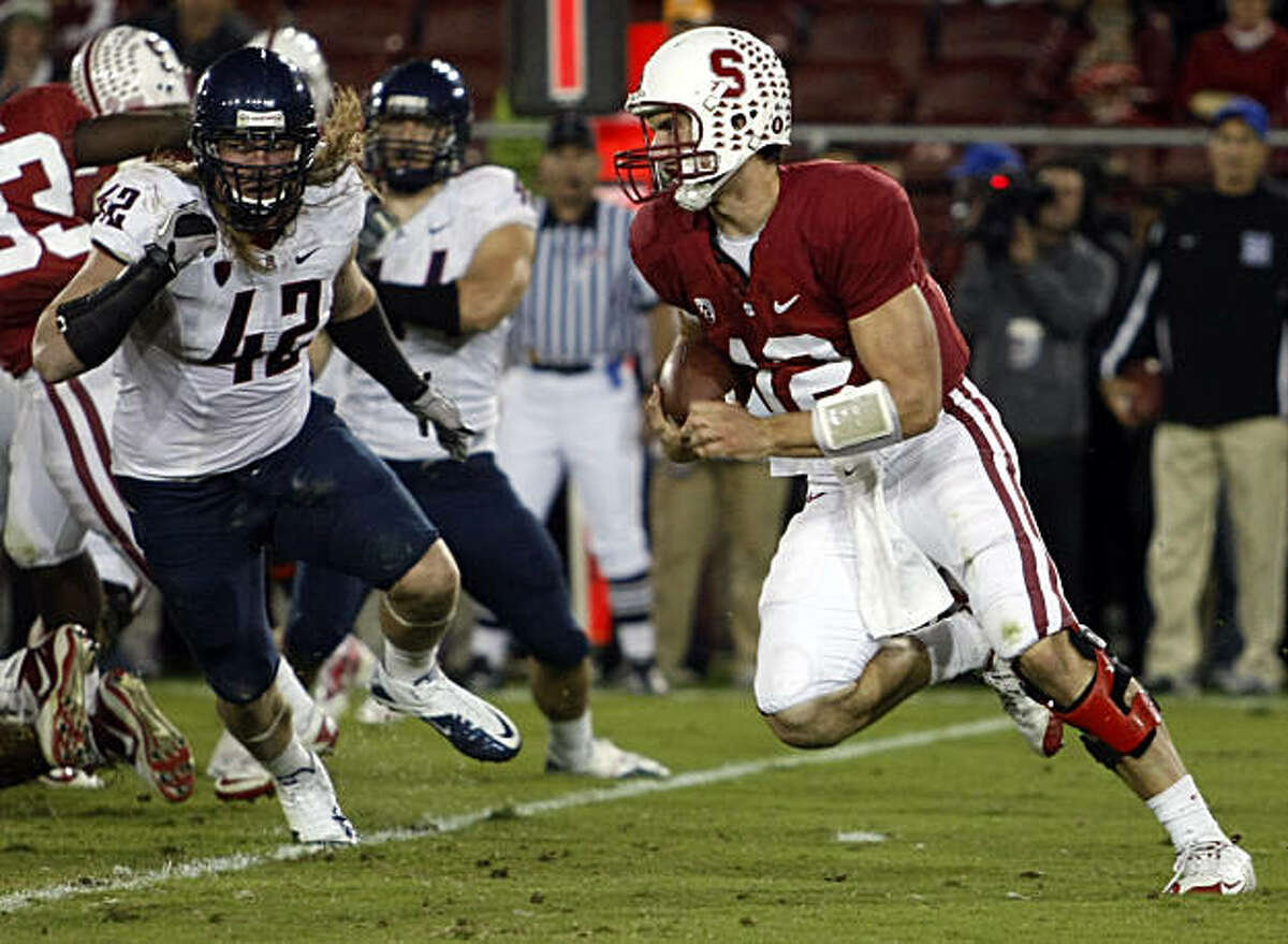 Andrew Luck runs on an option play as Stanford takes on the Arizona Wildcats at Stanford Stadium on Saturday.