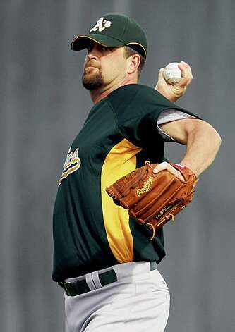 Oakland Athletics pitcher Russ Springer warms up during Spring Training workouts at the Papago Baseball Facility Monday February 16, 2009 in Phoenix Arizona Photo: Lance Iversen, The Chronicle