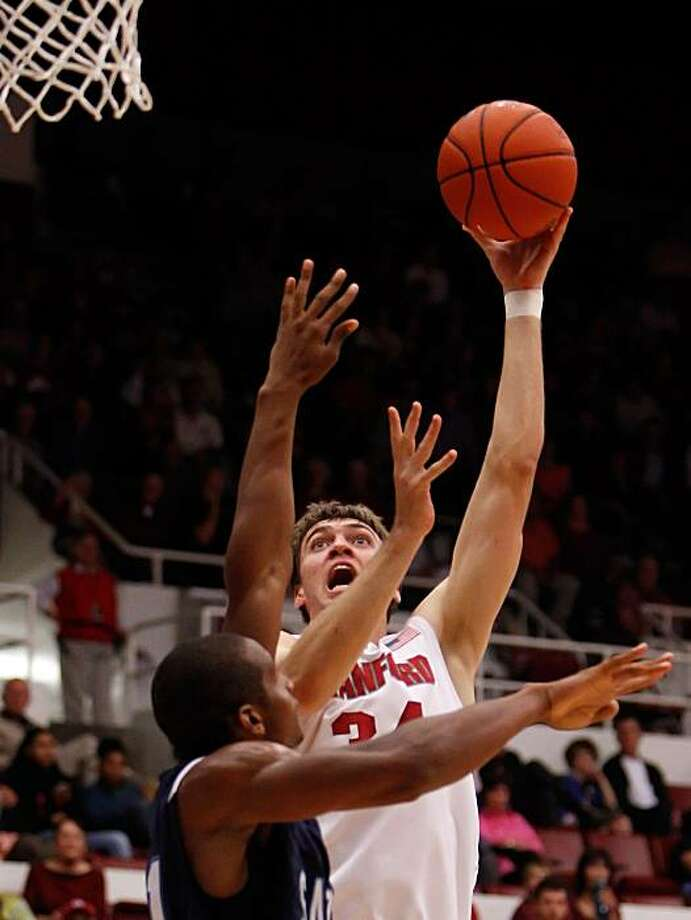 Andrew Zimmermann puts up a shot in the first half at Maples Pavilion at Stanford University on Monday. Photo: Carlos Avila Gonzalez, The Chronicle