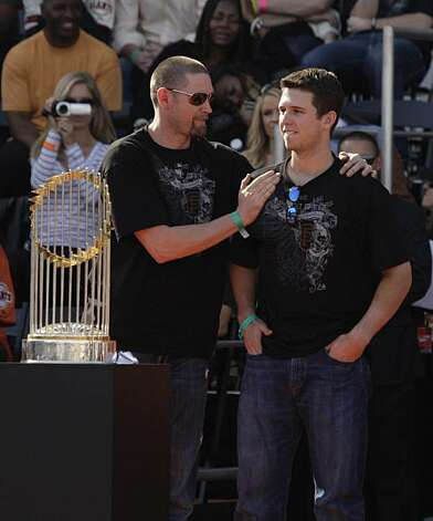 San Francisco Giants' Aubrey Huff and Buster Posey talk on stage  during the ceremony at Civic Center Plaza after the World Series parade celebrating the San Francisco Giants win in the 2010 World Series on Monday, November 3, 2010 in San Francisco, Calif. Photo: Lea Suzuki, San Francisco Chronicle