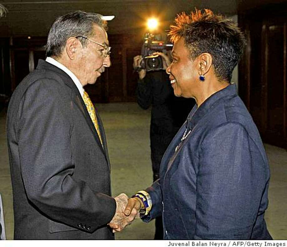 Cuban President Raul Castro (L) handshaks with US Congresswoman Barbara Lee-D (R), on April 06, 2009 at State Council in Havana. US lawmakers are visiting Cuba to try to end mutual distrust and amid reports that President Barack Obama was planning to ease economic sanctions, including travel restrictions on Cuban-Americans. Cuba's revolutionary leader Fidel Castro said his nation was not afraid of dialogue with the United States and did not want to extend the five decades of confrontation with its powerful neighbor.AFP PHOTO/Granma Newspaper/Juvenal Balan/HO (Photo credit should read JUVENAL BALAN NEYRA/AFP/Getty Images) Photo: Juvenal Balan Neyra, AFP/Getty Images