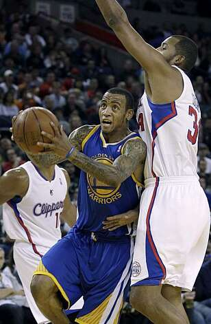 Golden State Warriors shooting guard Monta Ellis (8) drives past Los Angeles Clippers power forward Brian Cook (34) in the third quarter of an NBA basketball game in Oakland, Calif., Friday, Oct. 29, 2010. Photo: Jeff Chiu, AP