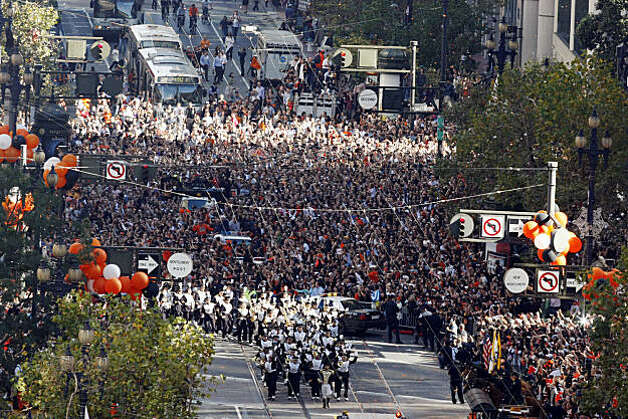 Fans flock to Market Street during a parade marking the Giants triumphant return from Texas as Wednesday, November 3, 2010, San Francisco, Calif.  The San Francisco Giants celebrate their 2010 World Series win after returning home. Photo: Adm Golub, The Chronicle
