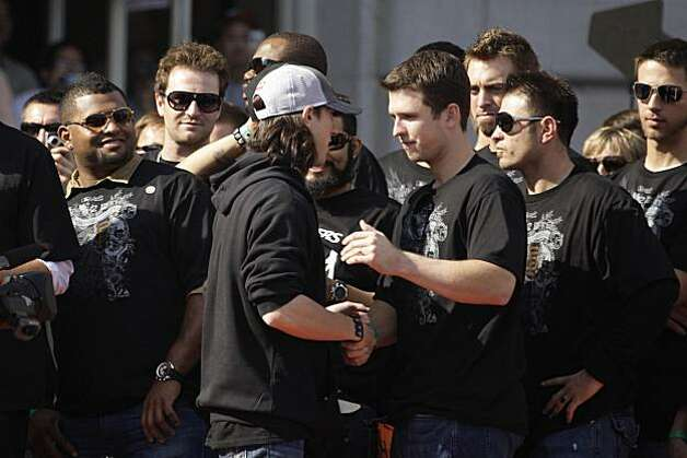 San Francisco Giants' pitcher Tim Lincecum (l to r) is greeted by Buster Posey and teammates after he is introduced during the ceremony in front of City Hall after the World Series parade celebrating the San Francisco Giants win in the 2010 World Series on Monday, November 3, 2010 in San Francisco, Calif. Photo: Lea Suzuki, San Francisco Chronicle