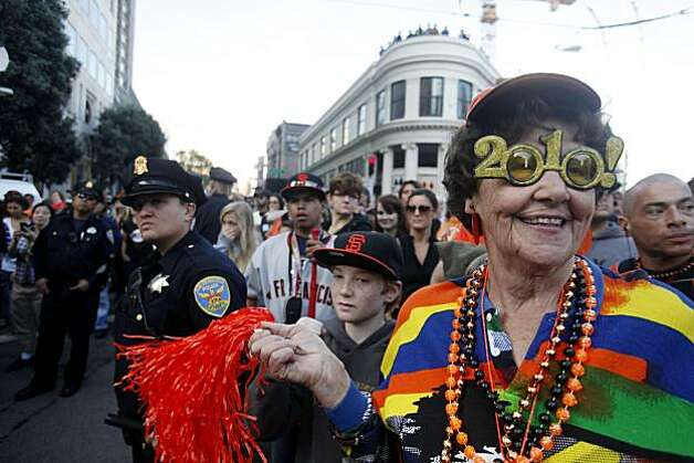 After the San Francisco Giants won the World Series, Flora Ballard waits at Washington and Montgomery Street for the start of the victory parade on Wednesday Nov. 03, 2010 in San Francisco, Calif. Photo: Mike Kepka, The Chronicle