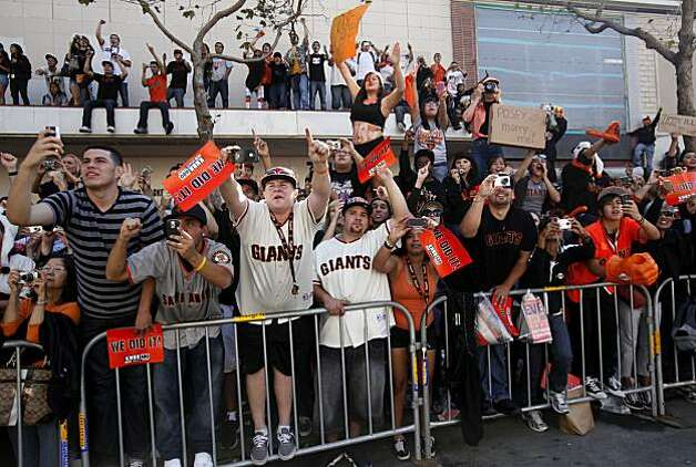 After the San Francisco Giants won the World Series, Fans watch the victory parade on Market Street on Wednesday Nov. 03, 2010 in San Francisco, Calif. Photo: Mike Kepka, The Chronicle