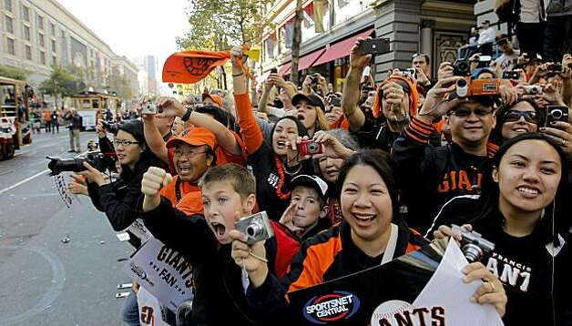 Fans cheer the Giants players along Market Street, as the City of San Francisco celebrates the World Series Champion Giants with a parade down Market Street, on Wednesday Nov. 3, 2010 in San Francisco, Calif. Photo: Michael Macor, San Francisco Chronicle