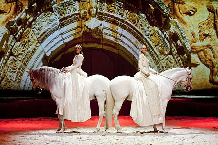"Two rider and their horses performs the act ""Le Miroir"" on stage at Cavalia: A Magical Encounter Between Horse and Human production at the White Big Top in China Basin in San Francisco, Calif. on Monday, Nov. 15, 2010. Photo: Stephen Lam, Special To The Chronicle"