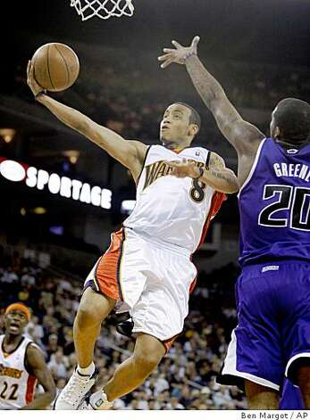 Monta Ellis lays up a shot past Donte Greene on Wednesday in Oakland. Photo: Ben Margot, AP