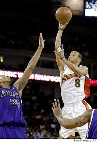 Golden State Warriors' Monta Ellis (8) shoots over Sacramento Kings' Jason Thompson during the second half. Photo: Ben Margot, AP