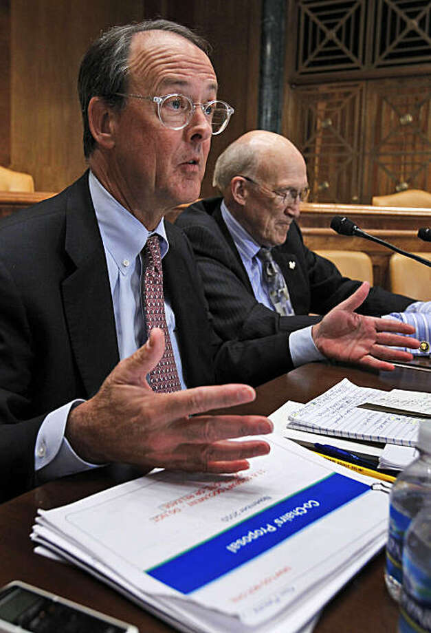 Erskine Bowles, left, accompanied by former Wyoming Sen. Alan Simpson, co-chairmen of President Barack Obama's bipartisan deficit commission, gestures while speaking on Capitol Hill in Washington Wednesday, Nov. 10, 2010. Photo: Alex Brandon, AP