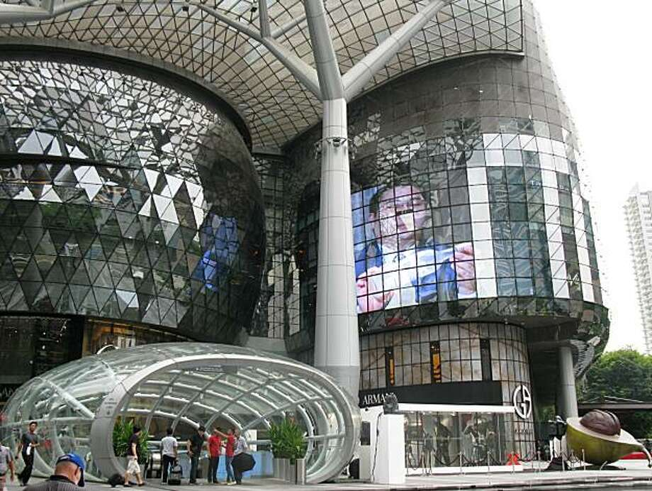 Multimedia art and live performances draw shoppers to Singapore's ION Orchard Shopping Center on the tony Orchard Road. The mall, four stories above aground and four stories below with its own Metro stop, has more than 300 stores and dining spots. October2010 Photo: Lois Kazafoff