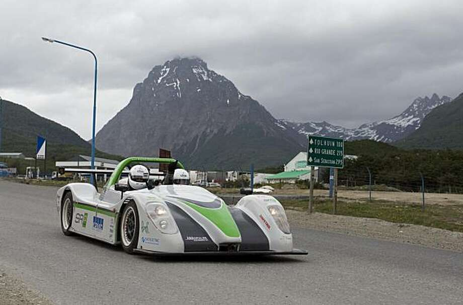 Alexander Schey and Toby Schulz, of the British eco-adventure Racing Green Endurance (RGE) team, gesture from the SRZero electric sports car upon arrival to Ushuaia, Argentina, Tuesday Nov. 16, 2010.  The SRZero became the first electric car to travel from Alaska's Prudhoe Bay to the world's southernmost city of Ushuaia. Photo: Alejandro Madril, AP