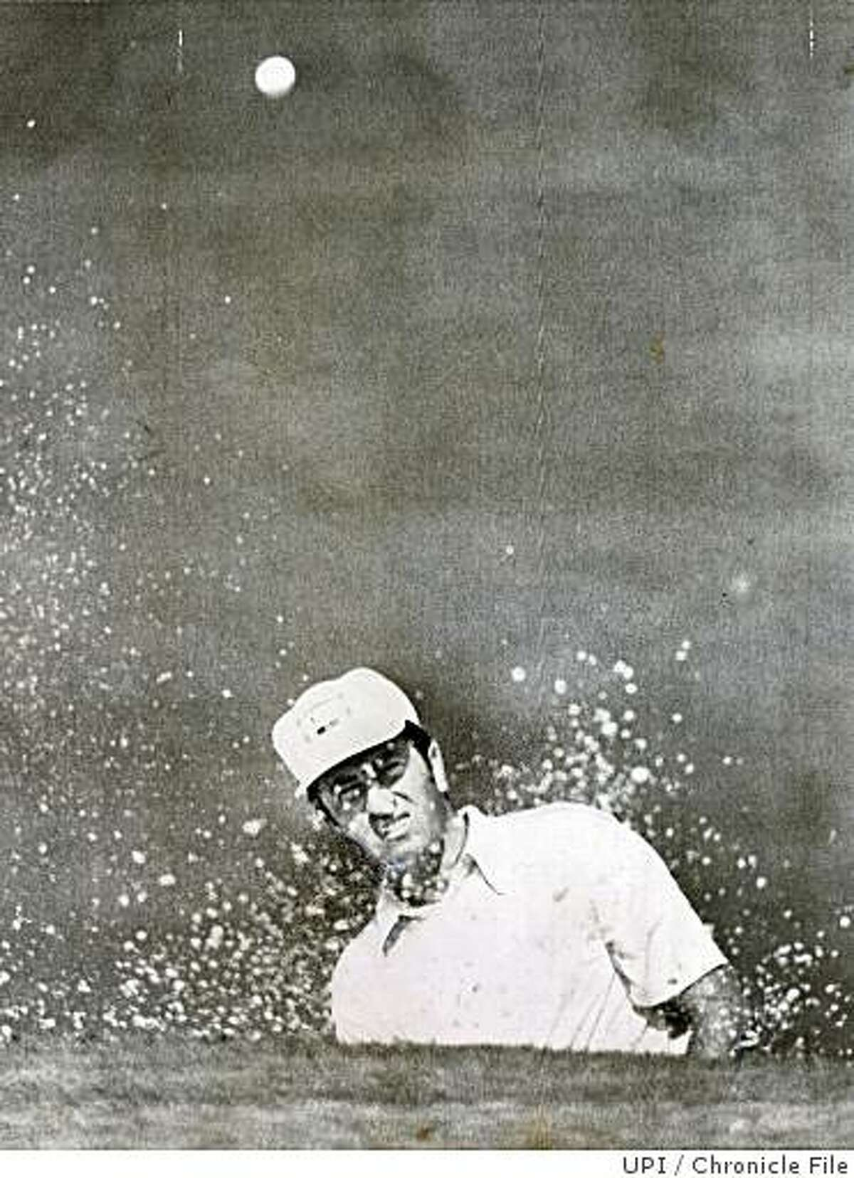Masters07.jpg April 6, 1972 - (MASTERS GOLF) AUGUSTA, GA: George Archer is almost lost from view as he goes behind a small hill to blast out of a sand trap during the opening round of the Masters.UPI Chronicle File