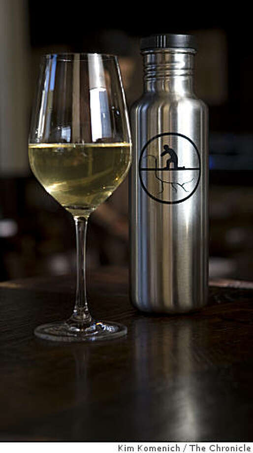 "Pinot Grigio from the Natural Process Alliance is served from stainless steel ""Kleen Kanteen"" containers at Nopa restaurant in San Francisco, Calif., on Tuesday, Mar. 24, 2009. NPA wine is made without sulfur or preservatives. Photo: Kim Komenich, The Chronicle"