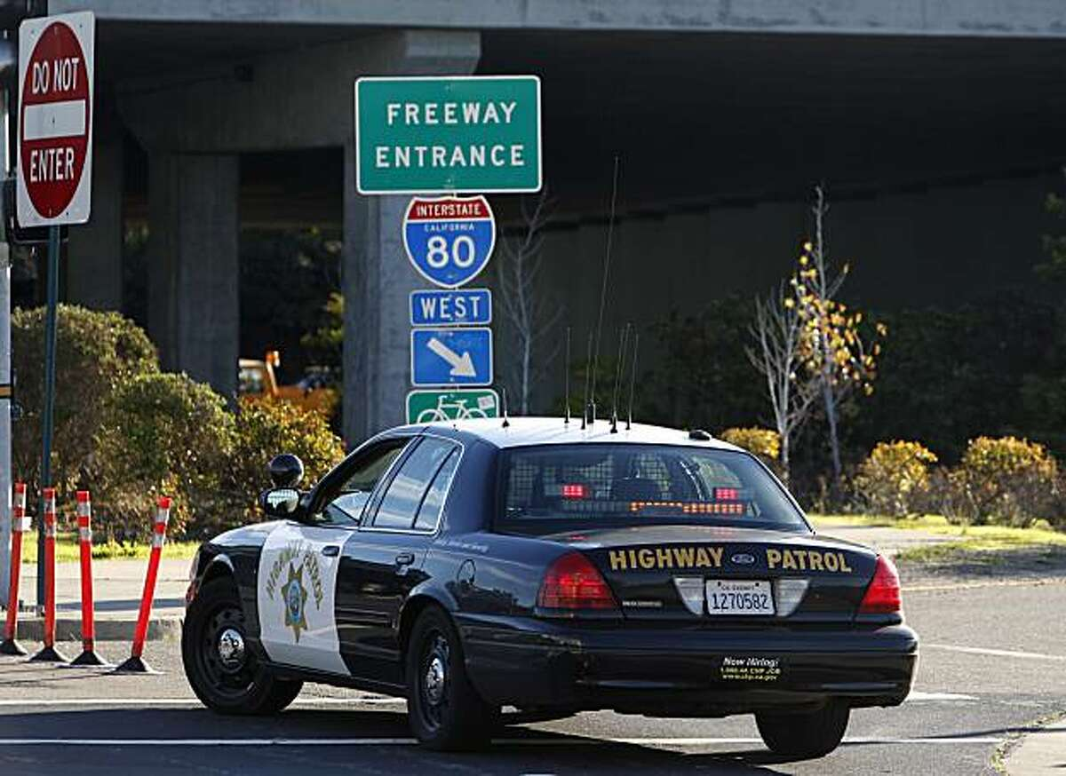 A Highway Patrol cruiser blocks an entrance to the westbound Bay Bridge on Powell Street in Emeryville, Calif., on Thursday, Nov. 11, 2010 after a man stopped his car on the upper deck of the span and threatened to kill himself, forcing authorities to shut down all westbound lanes for about two hours. Police officers eventually took the man into custody.