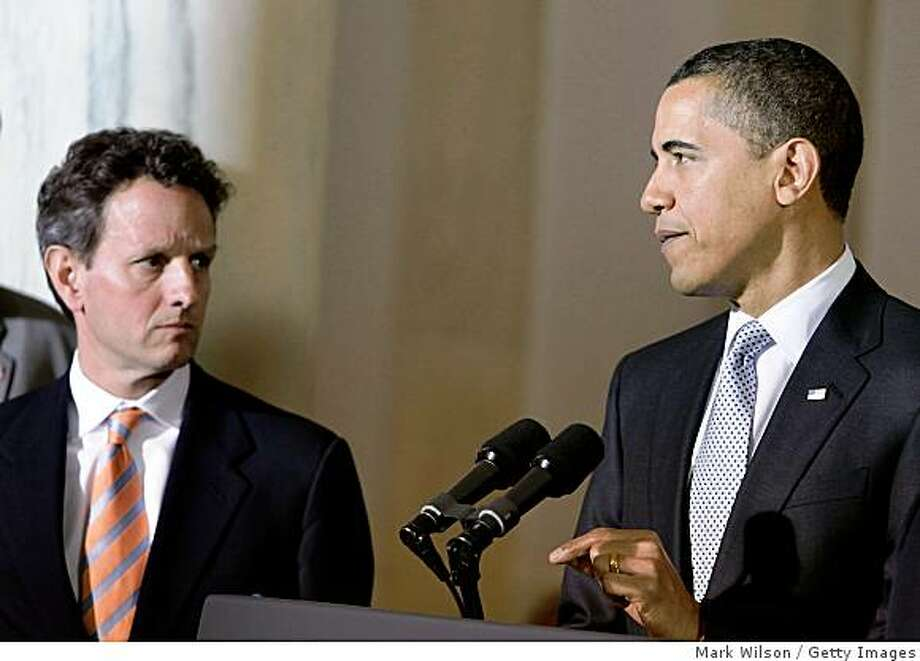 WASHINGTON - MARCH 30:  U.S. President Barack Obama (R), with Treasury Secretary Timothy Geithner, makes an announcement about the U.S auto industry at the White House March 30, 2009 in Washington, DC. Obama unveiled the details of his administration's plan to deal with the auto industry crisis.  (Photo by Mark Wilson/Getty Images) Photo: Mark Wilson, Getty Images