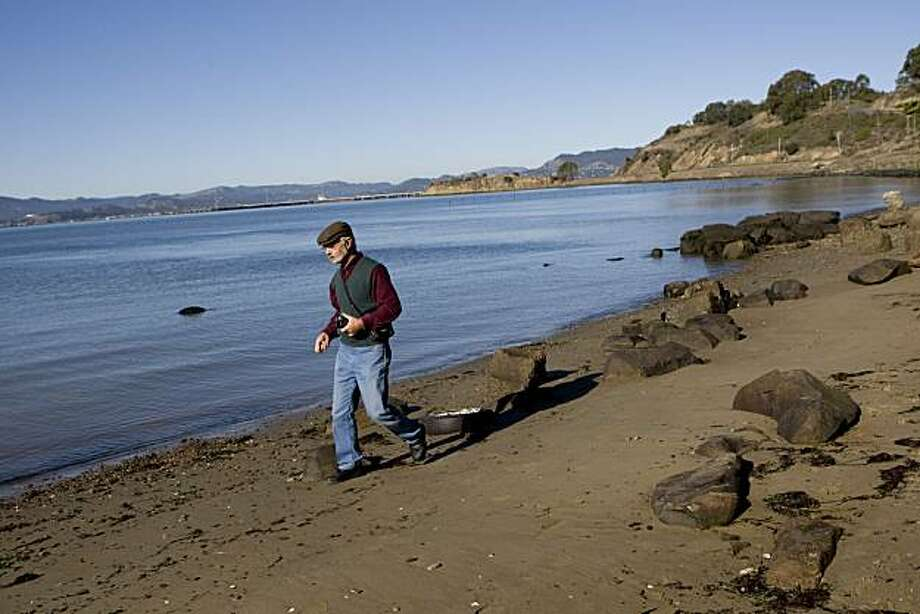 Donald Bastin, a member of the Trails for Richmond Action Committee, walks along Point Molate Beach in Richmond, Calif., on Monday, Nov. 23, 2009. The one-time park has been closed for several years, but is set to reopen as part of the Bay Trail. Photo: Laura Morton, Special To The Chronicle