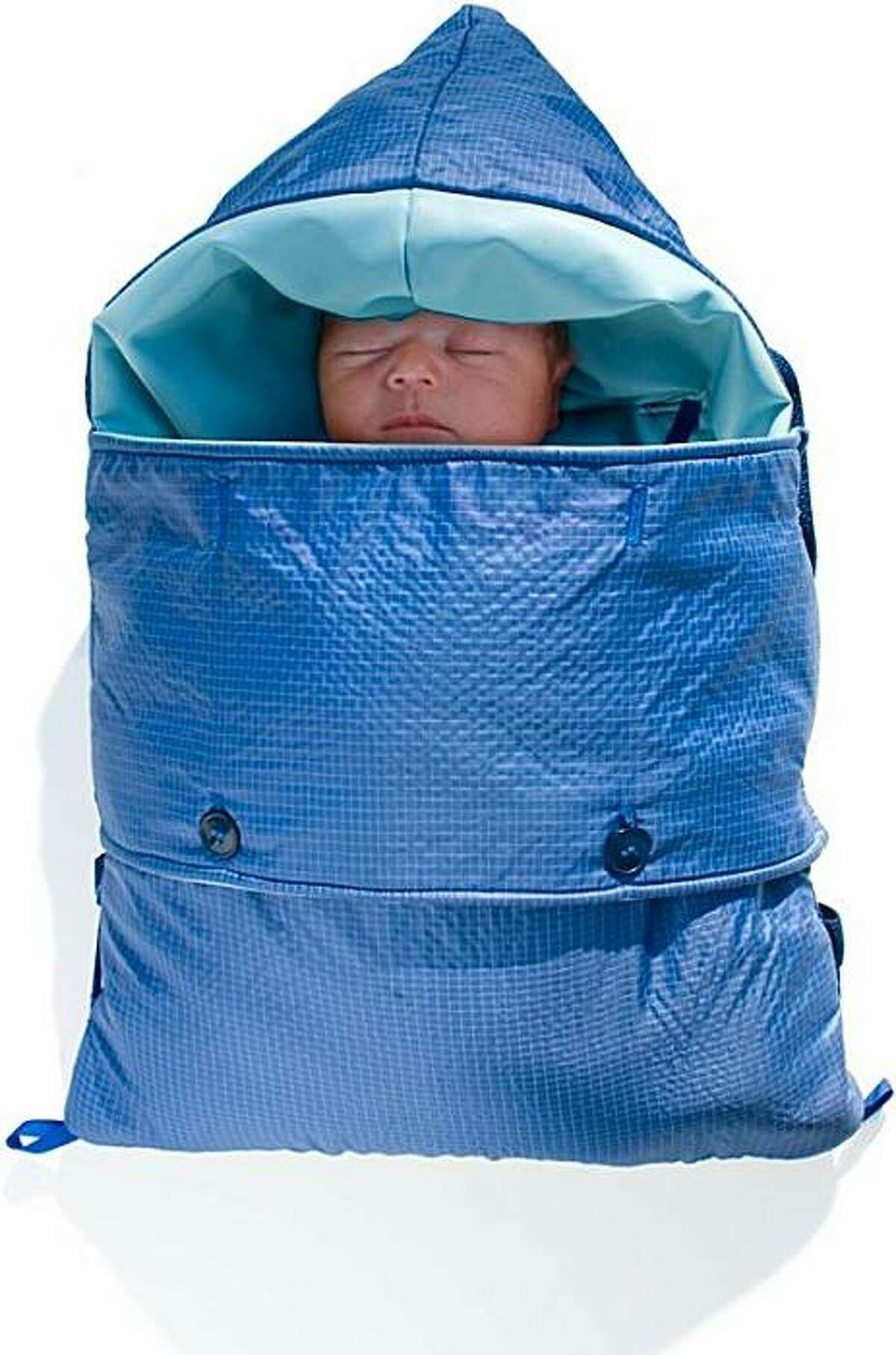 A baby is tucked into an early version of the Embrace Infant Warmer in 2009. Babies need to stay warm. No longer in their mother's cocoon, they need help keeping their body temperature up during their early days of life. It sounds simple, yet for millions of infants it can be a struggle, sometimes a fatal one. Embrace, a San Francisco social enterprise born out of a Stanford design class, is hoping to change the tide. Its incubator, which it plans to launch at the end of this year, can keep babies snug at a fraction of the cost of a traditional one. Globally more than 20 million babies are born premature or with low birth weight each year, according to the World Health Organization. Four million of them die within the first four weeks of life.