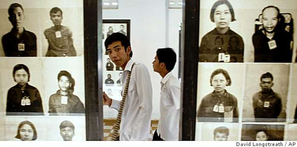 """Cambodian students visit Toul Sleng Genocide Museum Monday, March 30, 2009, in Phnom Penh, Cambodia. The former commander of the torture prison, Kaing Guek Eav, also know as """"Duch,"""" is the first of five former Khmer Rouge leaders being tried for crimes against humanity. With no death penalty in Cambodia, the maximum sentence """"Duch"""" could face would be life imprisonment. (AP Photo/David Longstreath)"""