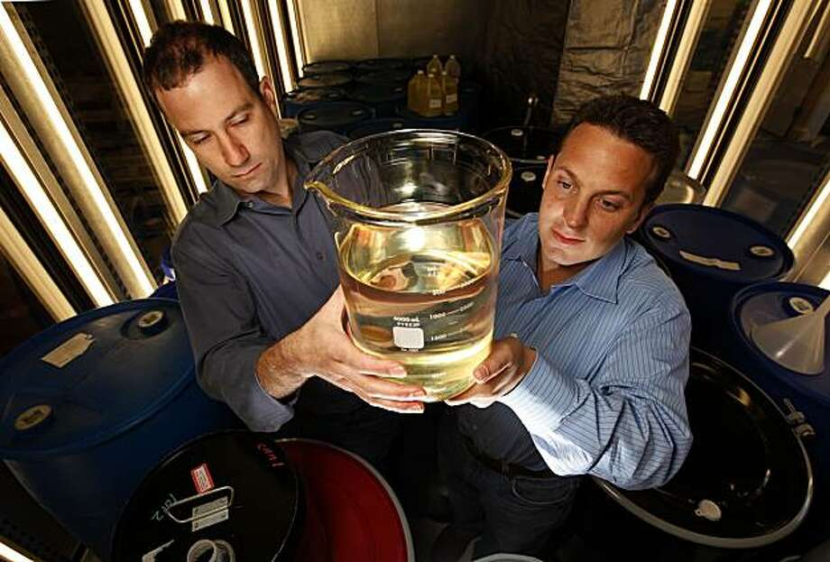 "Company founders, Harrison Dillon, (left) and JonathanWolfson hold a beaker filled with jet fuel,  on Friday April 3, 2009, one of many biofuels produced by the company, ""Solazyme"" in South San Francisco, Calif. The search for biologically-derived transportation fuels has exploded into a drag race for local Bay Area researchers. Photo: Michael Macor, The Chronicle"