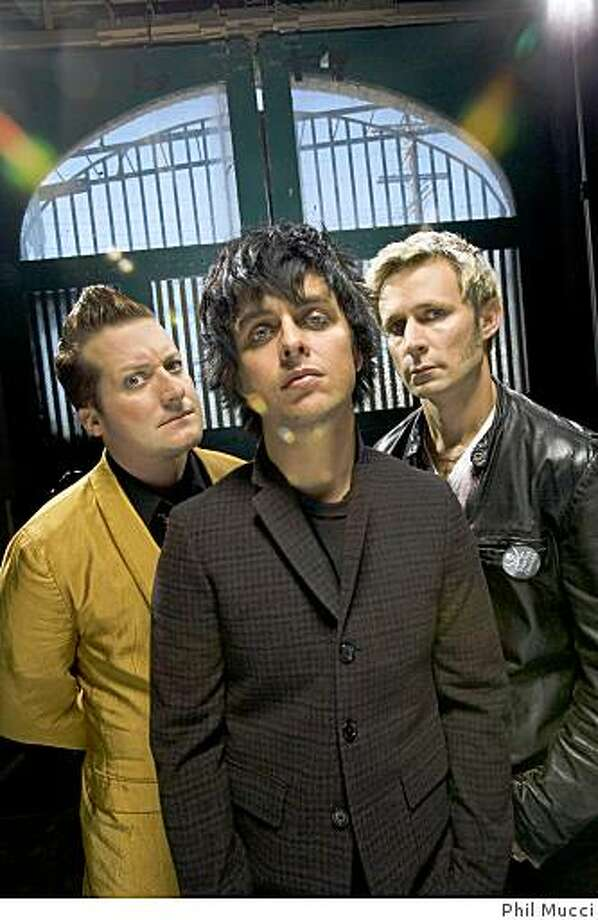 Tre Cool (left), Billie Joe Armstrong and Mike Dirnt, collectively known as the band Green Day Photo: Phil Mucci