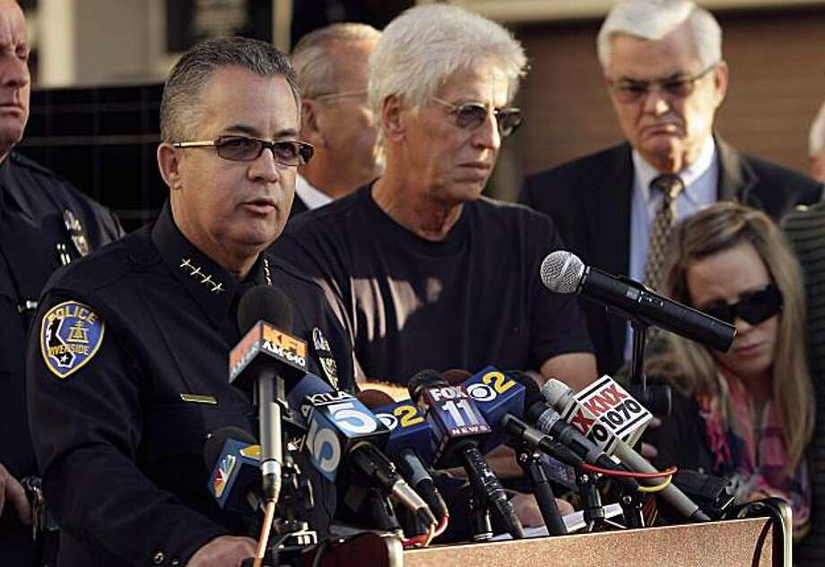 Riverside Chief of Police Sergio Diaz talks about officer Ryan Bonaminio on Tuesday, Nov.  9, 2010 during a news conference outside the Riverside Police Department in Riverside, Calif.  as Ryan's father Joseph and sister Nicole, right, look on.    Bonaminio, 27, a four-year member of the department and an Iraq War veteran, was on patrol  late Sunday when he pulled over  a truck. The driver got out and Bonaminio chased him into nearby Fairmount Park. The two exchanged gunshots and at least one hit Bonaminio, Lt. Leon Phillips said.   Backup officers found him on the ground, and he was declared dead at a hospital.  (AP Photo/The Press Enterprise, Stan Lim)   MANDATORY CREDIT, NO SALES, MAGS OUT Photo: Stan Lim, AP