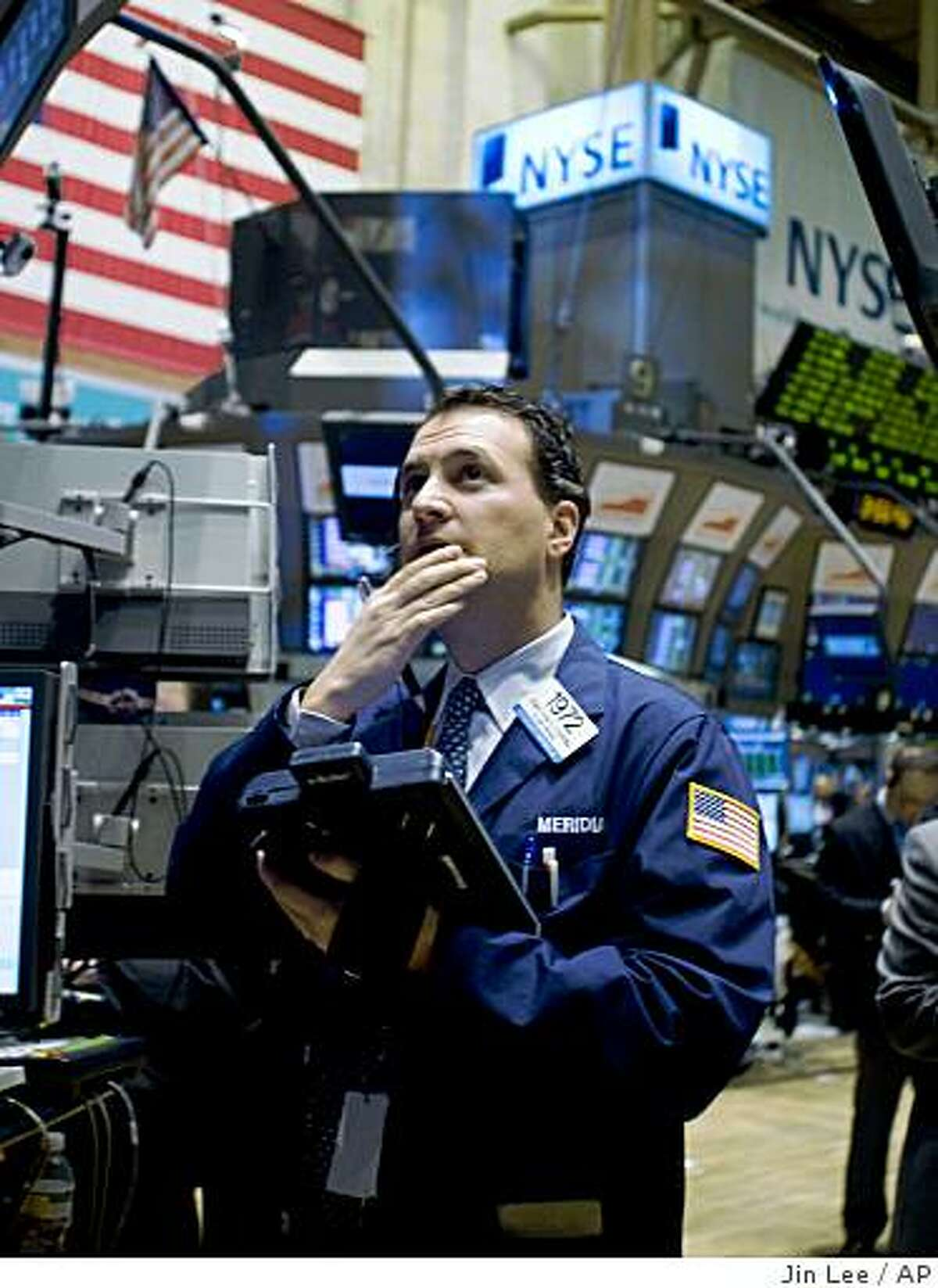 A trader works on the floor of the New York Stock Exchange on Thursday, April 2, 2009 in New York. Investors dove into stocks on Thursday as global efforts to end the financial crisis fed the market's newfound optimism that the economy is on the mend. (AP Photo/Jin Lee)
